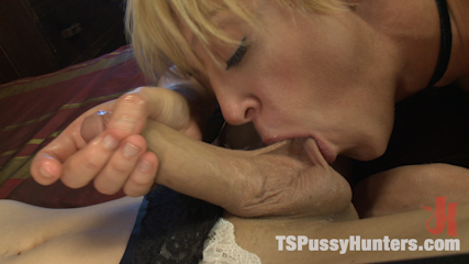 Darling is Thrilled to suck on the Madame's massive cock and take it in her ass and pussy.